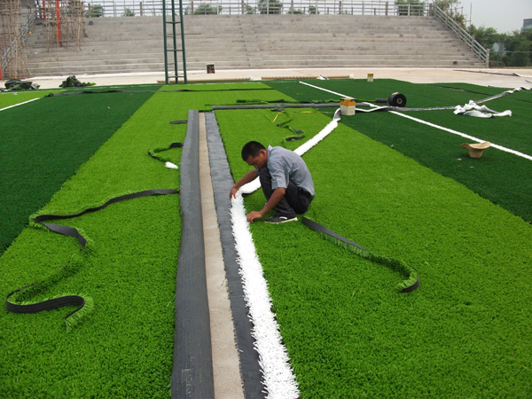 Artificial turf filling particles